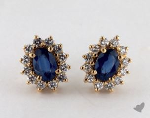 18K Yellow Gold Starburst 1.15tcw Oval Blue Sapphire and Diamond Earrings.