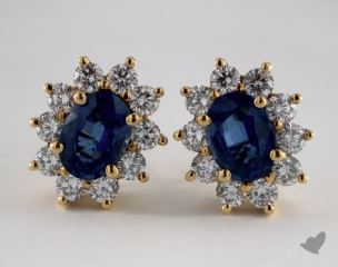18K Yellow Gold Starburst 2.03tcw Oval Blue Sapphire and Diamond Earrings.